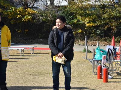設営前の朝礼での榊原顕太郎会長